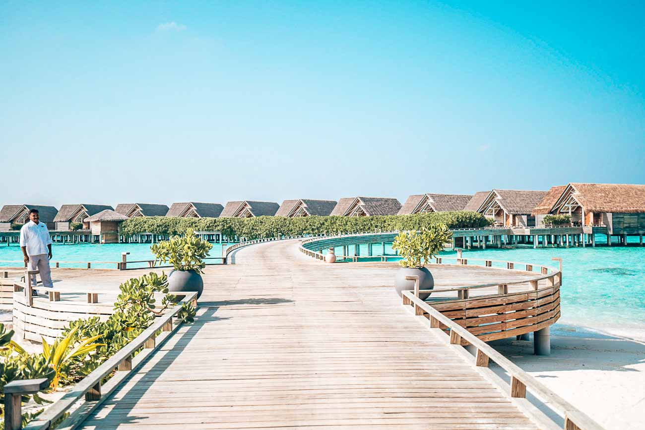 walkway to water pool villa milaidhoo maldives