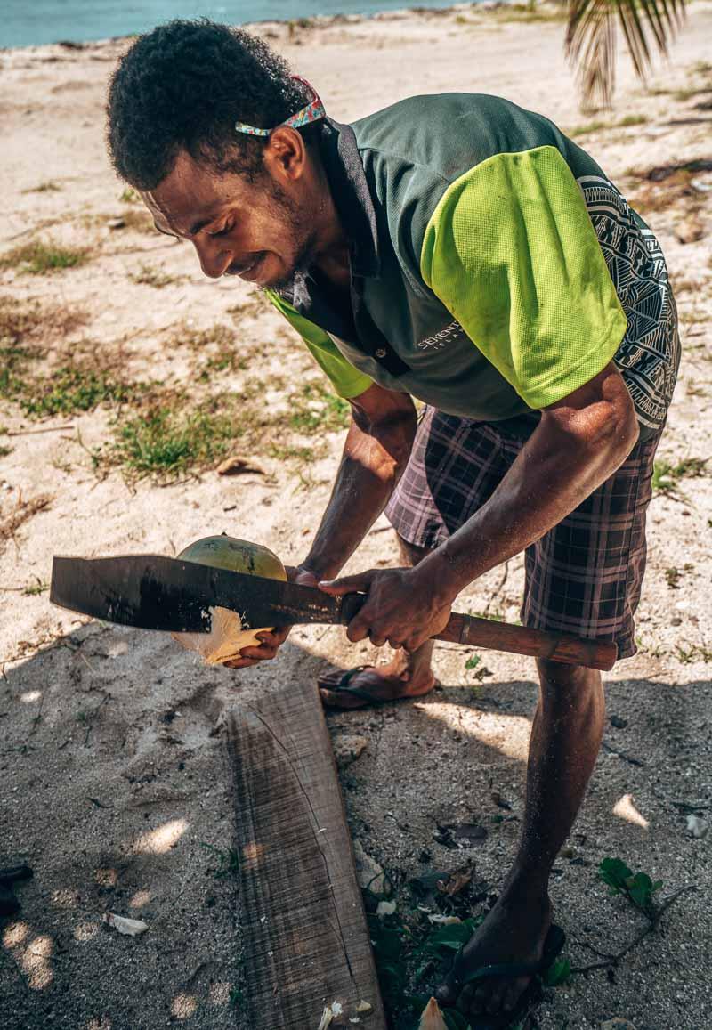 misa cutting coconuts at serenity island fiji
