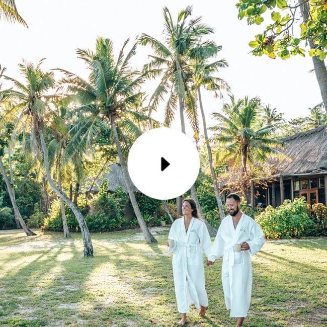 yasawa island resort and spa couple walking outside beach bure