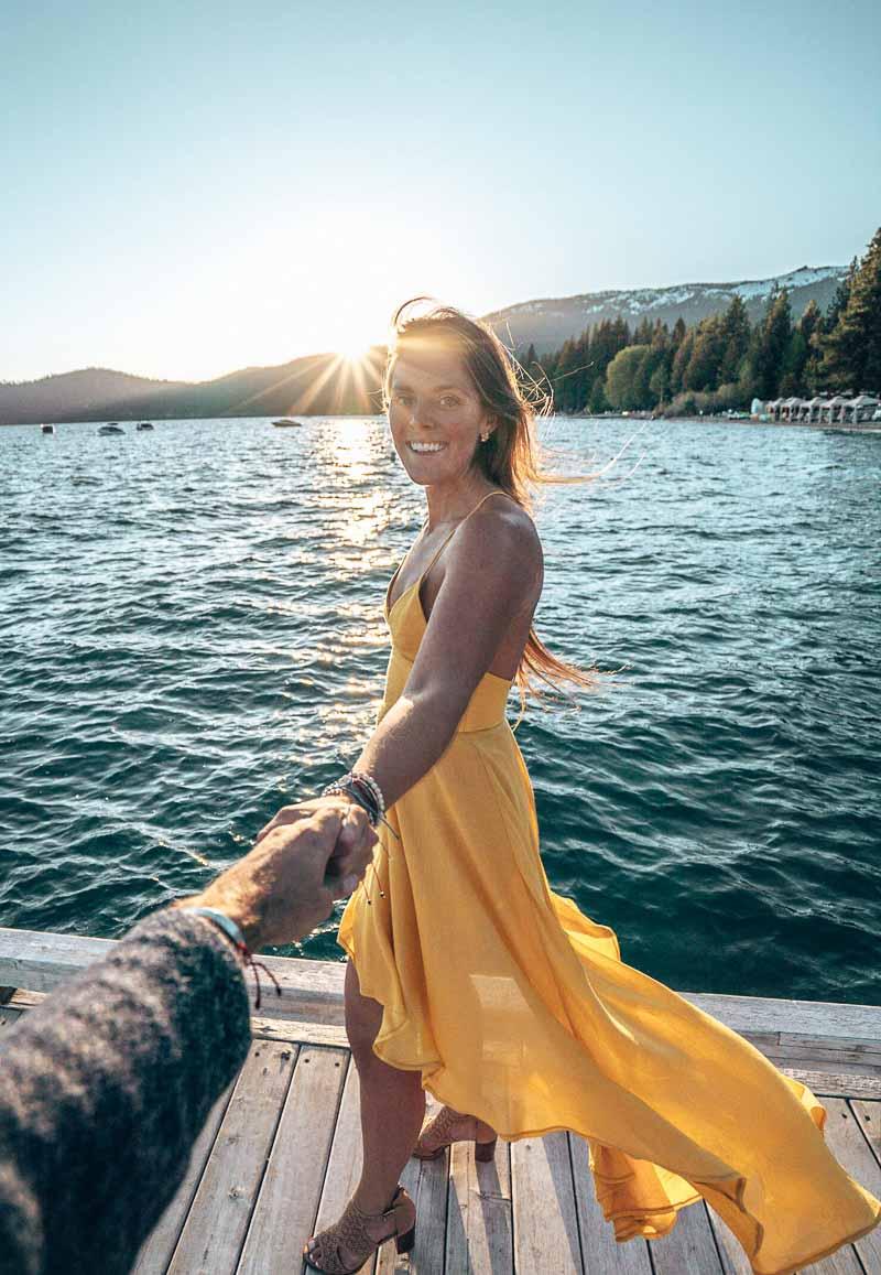 woman dancing at sunset lake tahoe