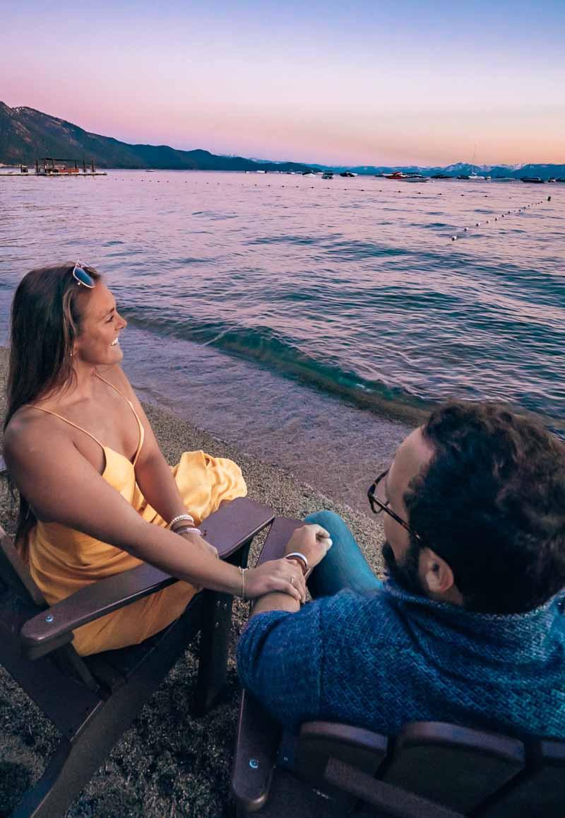Couple watching lake tahoe sunset